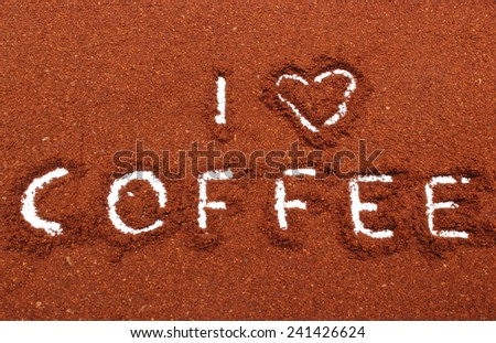 Coffee word written on ground coffee - stock photo