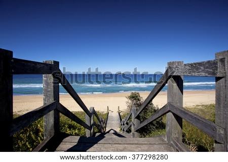 Coffs harbor boardwalk to beach - stock photo
