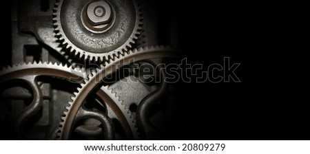 Cog and wheel details from machines of the industrial revolution with copy space - stock photo