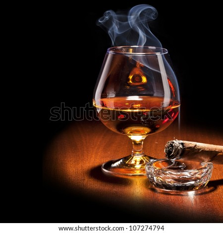 Cognac and Cigar with Smoke on black background - stock photo