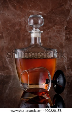 Cognac brandy in a bottle and glass - stock photo