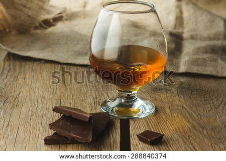 Cognac glass and chocolate horizontal selective focus