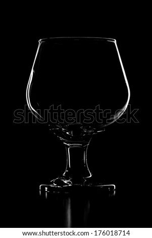 Cognac glass on black background - stock photo