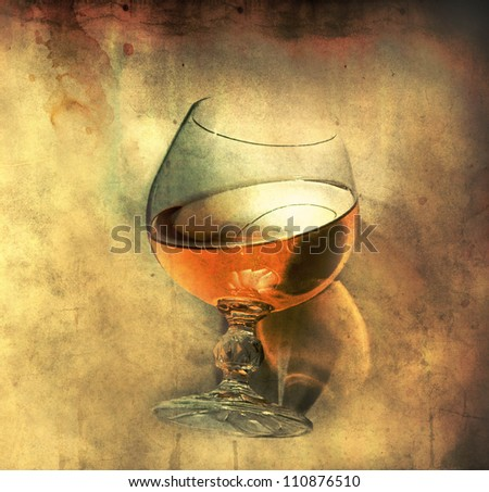 cognac glass on grunge background - stock photo