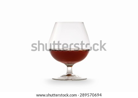 Cognac in glass isolated on white background - stock photo