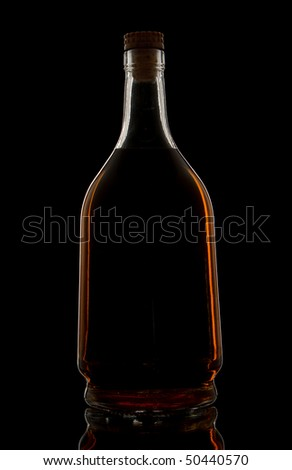 cognac isolated on black background - stock photo