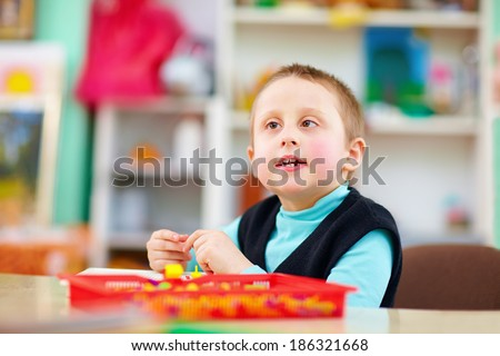 cognitive development of kids with disabilities - stock photo