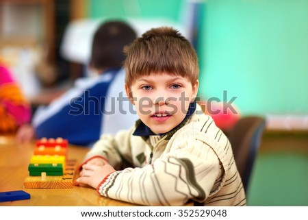 cognitive development of young kid with disabilities - stock photo