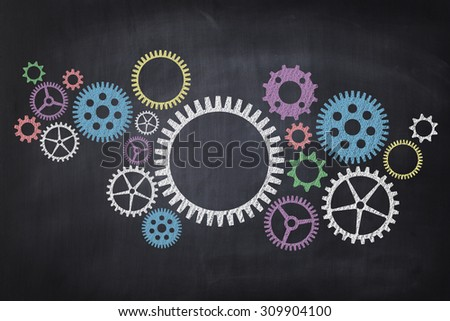 Cogwheel on Blackboard