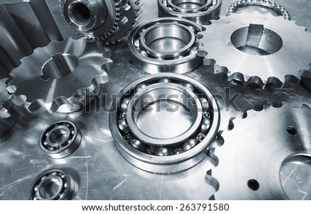 cogwheels and ball-bearings, aerospace engineering, titanium and steel - stock photo