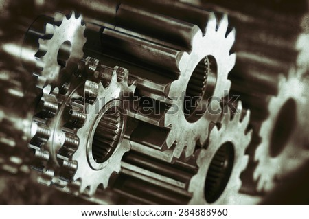 cogwheels and gears in titanium and steel, analog processing concept - stock photo