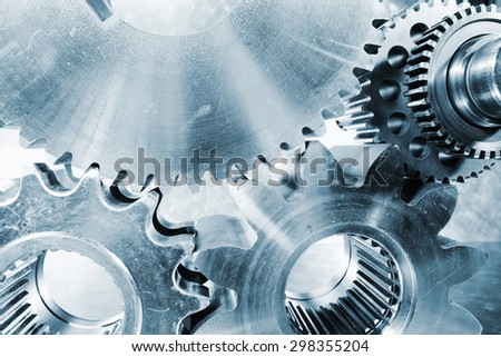 cogwheels and gears, titanium aerospace parts and tools, blue toning concept - stock photo