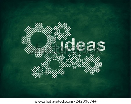 Cogwheels and ideas concept on blackboard - stock photo