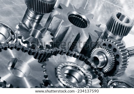 cogwheels, gears and timing-chain, aerospace parts in titanium and steel - stock photo