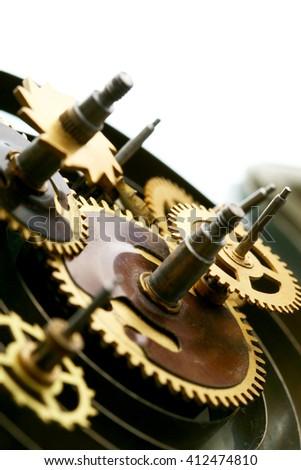 Cogwheels of old clock mechanism macro - stock photo