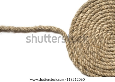 Coil of old hemp rope on white background