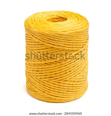 Coil of yellow synthetic rope isolated on white background. - stock photo