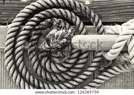 Coiled dock line with cleat.