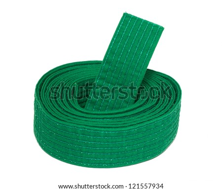 Coiled karate green belt isolated on white background