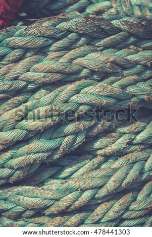 Coiled nautical rope.Vintage marine background