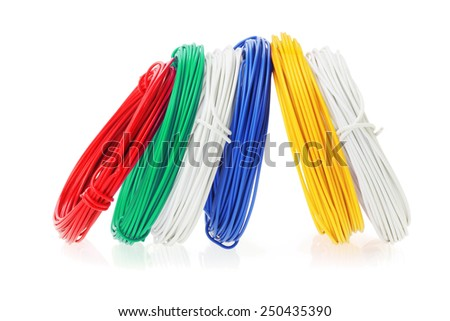 Coils of Color Wires Standing in a Row on White Background - stock photo