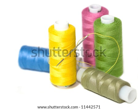 Coils of colour threads isolated on white