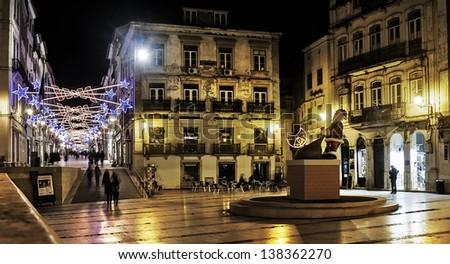 COIMBRA, PORTUGAL - DECEMBER 1: View of central May 8 Square at night, site of the townhall on December 1, 2012 in Coimbra, Portugal. Christmas setting on the street. - stock photo