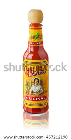 Coimbra, PORTUGAL- JULY 1, 2016: A bottle of Original flavor Cholula Hot Sauce on a white background. Cholula is a Mexican hot sauce made with pequin and arbol peppers blended with spices and vinegar.