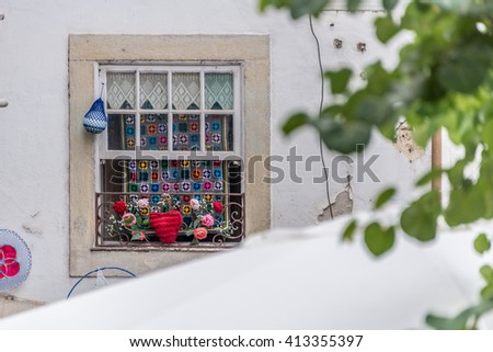 COIMBRA, PORTUGAL - 15 JULY 2015: Colorful and elaborate crochet made by city residents hangs suspended above the streets of the city during the third annual crochet festival, 2015.