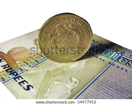 Coin and banknote Seychelles - stock photo