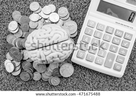 coin and calculator  with black and white color in business concept