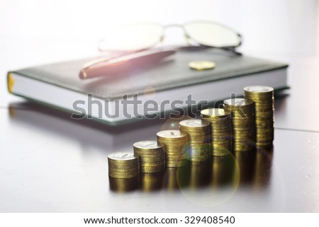 coin exchange rate glasses pen notebook