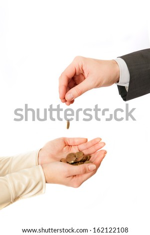Coin fall from masculine hand to female hands