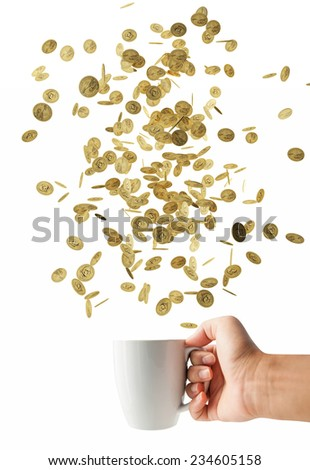 coin falling in white cup, Financial concept - stock photo