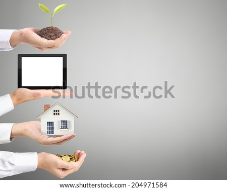 coin, house, tablet, trees, to money in hand, Business idea - stock photo