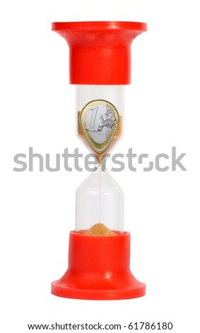 Coin in sand-glass isolated on white background - stock photo