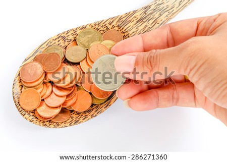 coin in wooden spoon in business concept