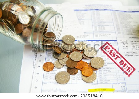 coin jar with money on Past Due medical bills - stock photo