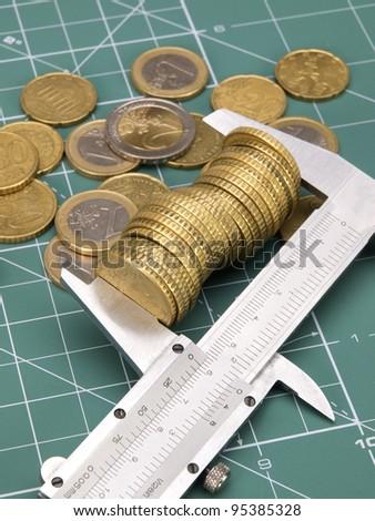 Coin measuring - stock photo