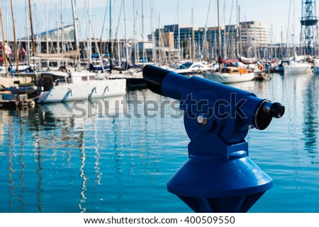 coin operated binoculars at a harbour - stock photo