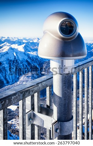 coin operated binoculars at a observation point - european alps