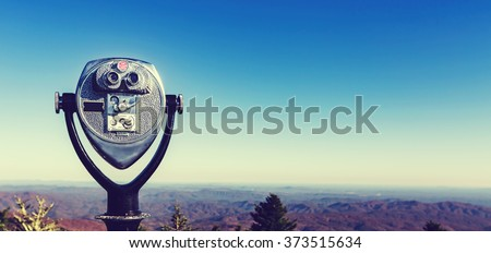 Coin-operated binoculars looking out over the Blue Ridge Mountains, NC - stock photo