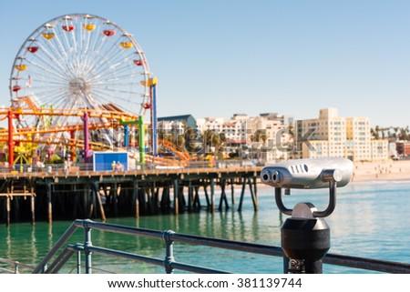 coin operated binoculars on santa monica pier, california - stock photo