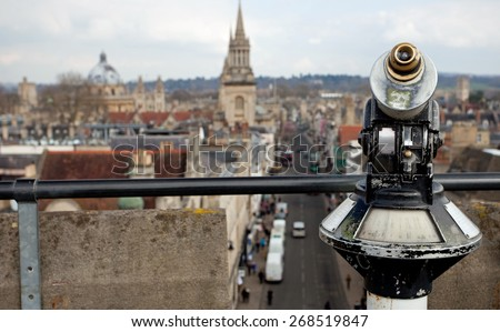 Coin operated binoculars with Oxford in the background