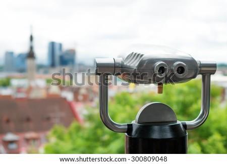 Coin operated panoramic telescope. - stock photo