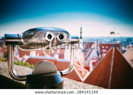 Coin Operated Telescope Binocular For Sightseeing At Town Tallinn Background - stock photo