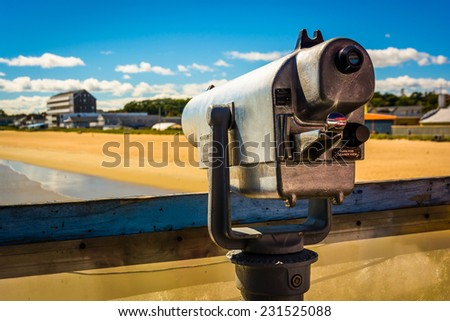 Coin operated telescope on the pier at Old Orchard Beach, Maine. - stock photo