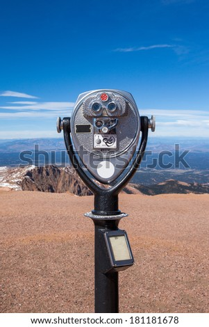 Coin operated telescope on the top of Pike peak summit, Colorado springs. - stock photo