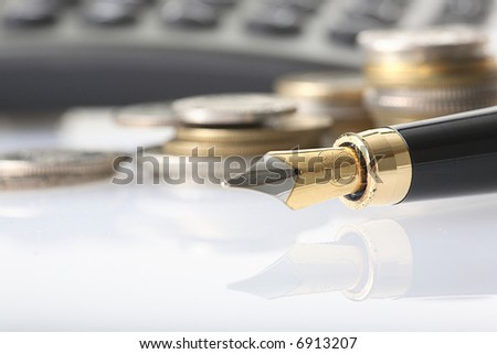 coin, pen and calculator - stock photo