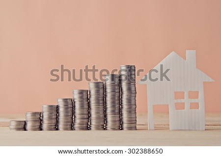 coin stack and house model , saving plan - stock photo